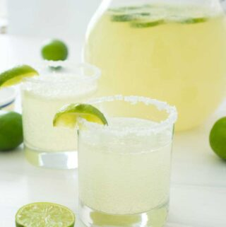 margarita punch in salt lined glass with lime wedge