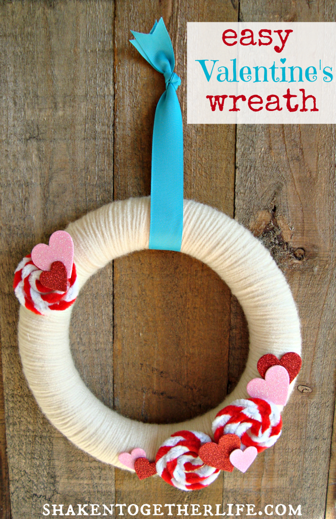 Super cute Valentines wreath with pipe cleaner rosettes