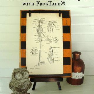 Spooky striped Halloween plaque with FrogTape at shakentogetherlife.com