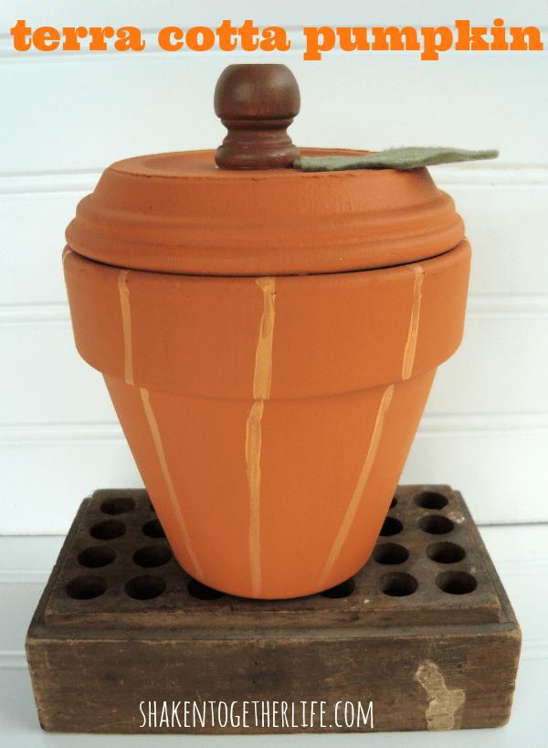 An easy Fall craft - use a terra cotta pot & saucer to make a painted pumpkin!