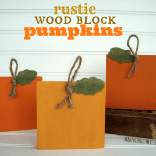 Rustic wood block pumpkins at shakentogetherlife.com