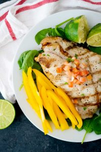 lime butter grilled grouper with yellow sliced bell pepper and pico de gallo