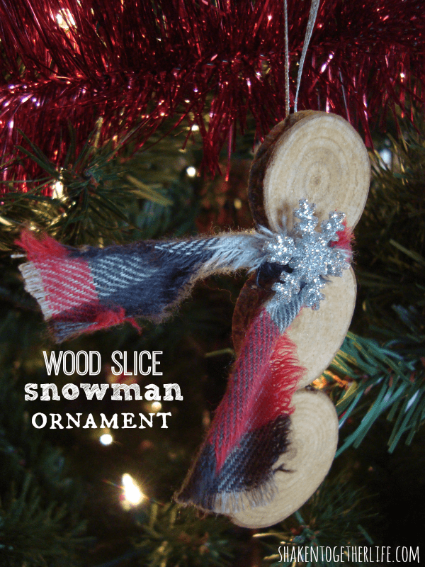 Easy and rustic wood slice snowman ornament at shakentogetherlife.com