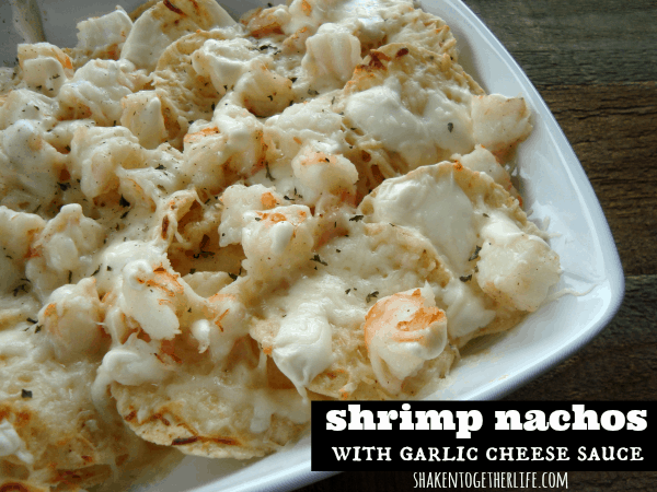 Shrimp nachos topped with an ooey gooey creamy garlic cheese sauce