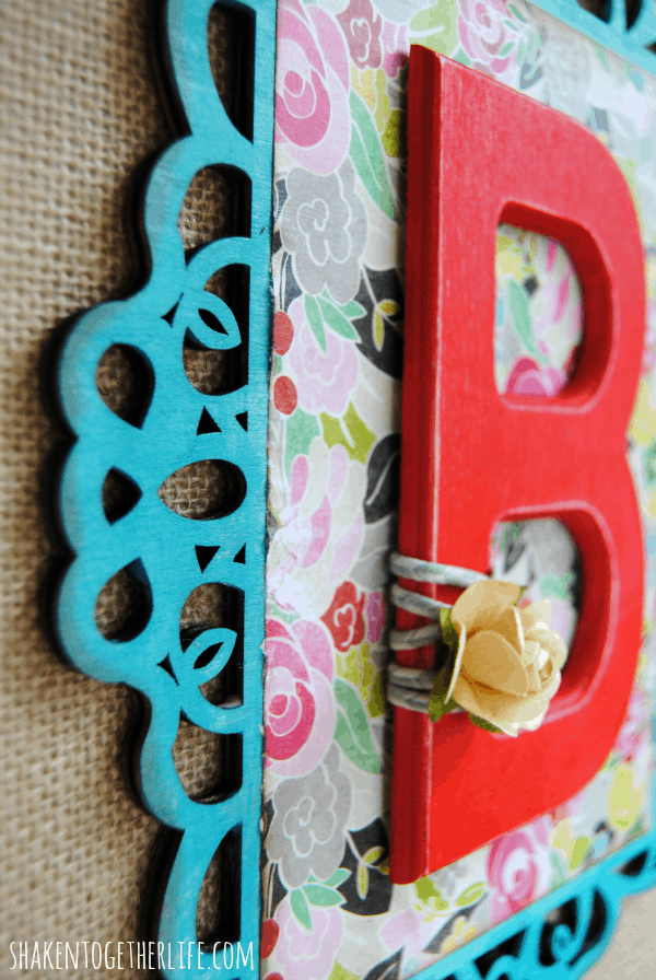 Love the bright colors and layers on this wooden monogram burlap canvas!