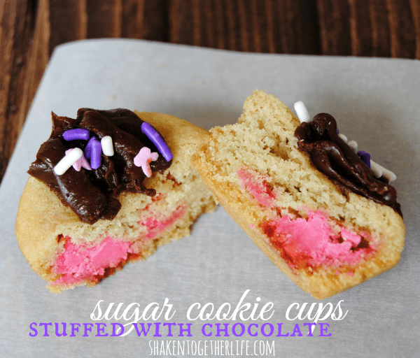 Colorful Spring chocolate chips are stuffed inside sugar cookie cups for a sweet Spring treat!