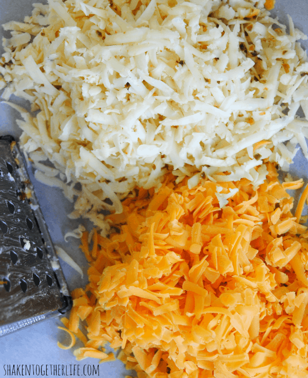 Piles of sharp cheddar and pepperjack cheeses just waiting to become homemade pepperjack pimento cheese!
