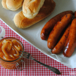 Smoky bourbon sausages with BBQ onions