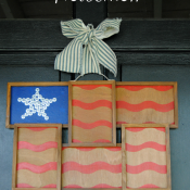 A rustic striped flag made from a repurposed photo frame - love this in place of a traditional wreath!