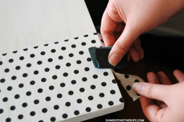 Sand paper is an easy way to get rid of any tissue paper that extends over the edge of your sign.