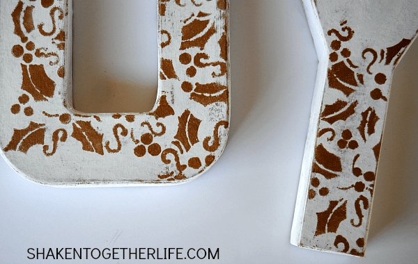 Craft store paper mache letters get a white and gold stenciled makeover to look like faux wood letters! Easy step by step tutorial!