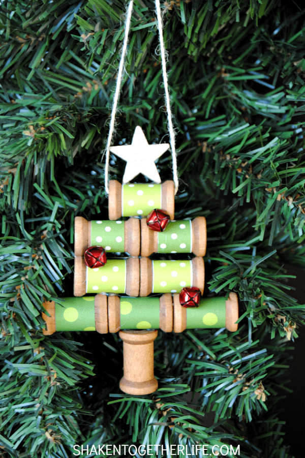 Make a wooden spool Christmas tree ornament with a few basic supplies - love the jingle bell ornaments!