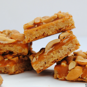 Butterscotch caramel cashew cookie bars - brown sugar cookie, spread with rich butterscotch caramel and topped with crispy salted cashews!