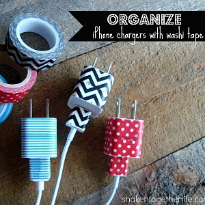 Organize your iPhone chargers with washi tape - no more lost or mixed up plugs and cords!