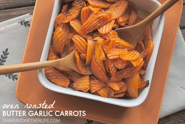 Easy and delicious, these Oven Roasted Butter Garlic Carrots are done in 30 minutes! Bet you can't eat just one!
