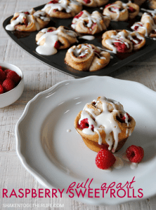 Pull apart raspberry sweet rolls start with refrigerated biscuits, are then filled with fresh tangy raspberries & drizzled with a sweet cream cheese glaze!