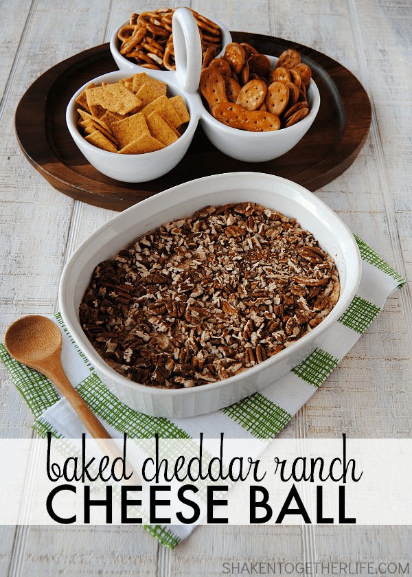 Baked Cheddar Ranch Cheese Ball! We baked our favorite cheese ball in the oven until it was warm & melty! Such a delicious recipe for your game day spread!Baked Cheddar Ranch Cheese Ball! We baked our favorite cheese ball in the oven until it was warm & melty! Such a delicious recipe for your game day spread!
