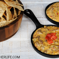 Don't let another day go by without making this awesome crock pot queso dip with beef & sausage! It is our go-to appetizer for game day, parties & potlucks!