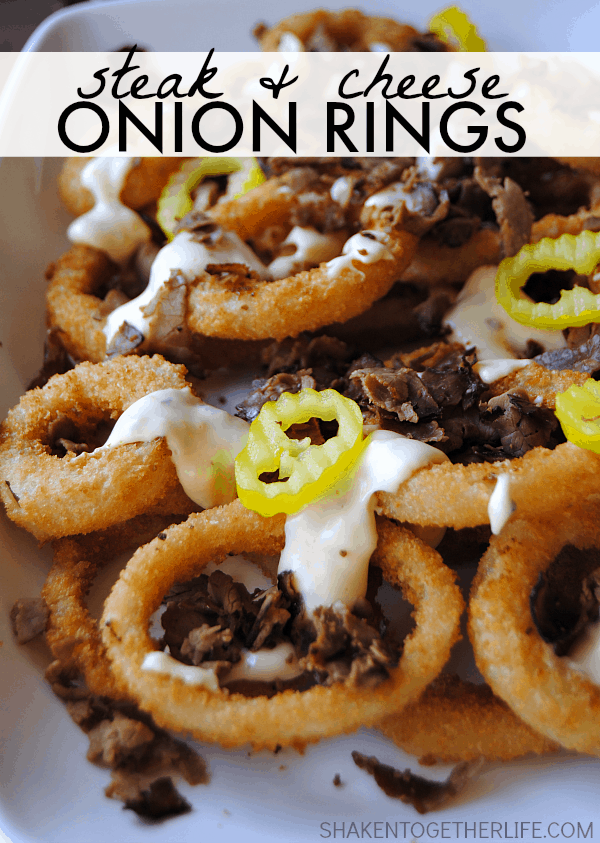 Now THIS is some serious game day grub - Steak & Cheese Onion Rings! Crispy onion rings, a cheesy sauce loaded with onions and peppers, topped with crispy seasoned roast beef!