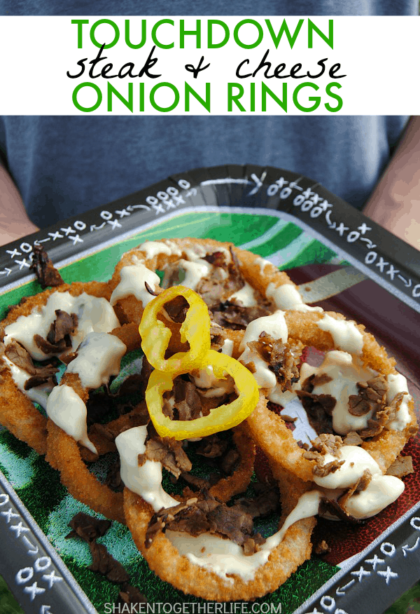 Now THIS is some serious game day grub - Steak & Cheese Onion Rings! Crispy onion rings, a cheesy sauce loaded with onions and peppers, topped with crispy beef!