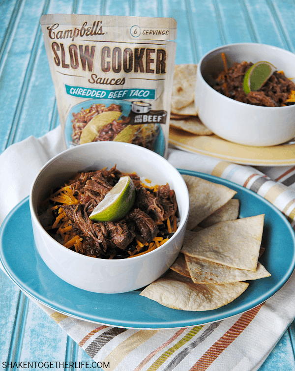 Slow Cooker Beef Taco Rice Bowls - layer rich saucy beef, rice, beans and cheese in a bowl and serve with homemade garlic tortilla chips and plenty of lime wedges!  #CampbellsSauces