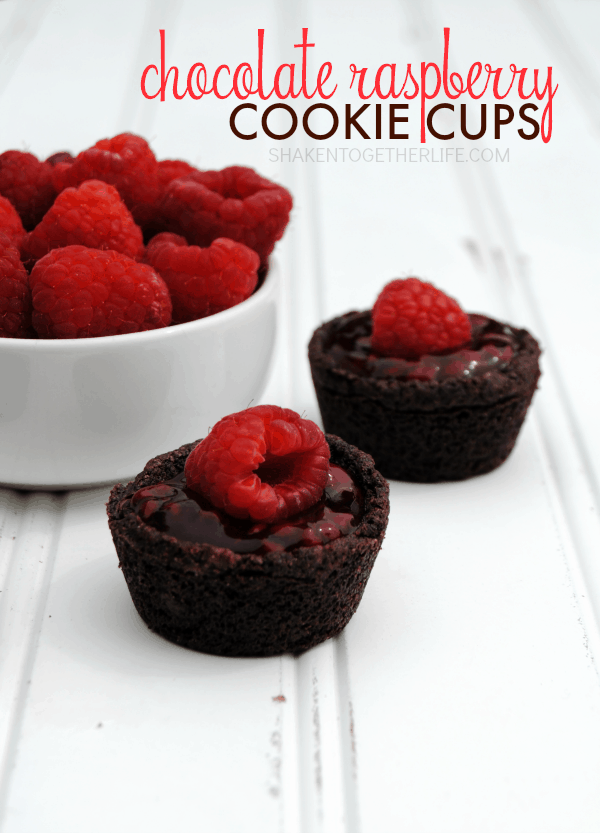 Chocolate Raspberry Cookie Cups - 2 bite double chocolate cookie cups filled with a sweet raspberry filling and topped with a fresh raspberry - YUM!
