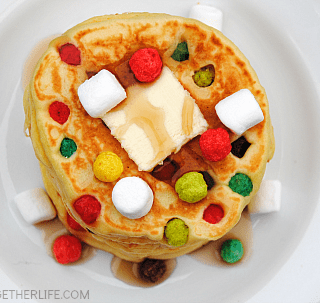 Rainbow Polka Dot Pancakes! Fruity rainbow cereal added to pancakes makes a delicious whimsical breakfast treat!