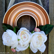 An old copper Jello mold - found at the Habitat Restore - was transformed into a beautiful and unique Spring Jello Mold wreath with a few simple supplies!