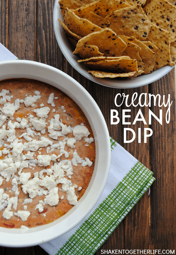 Creamy Bean Dip is an easy appetizer that is perfect for Cinco de Mayo! Beans, spices and cheese are baked until bubbly, then topped with crumbled cotija! SO easy and so delicious!