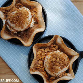 Dulce de Leche Fried Ice Cream Sundaes - cinnamon sugar tortilla bowls filled with ice cream, warm dulce de leche and a crispy sprinkling of toasted graham crackers!