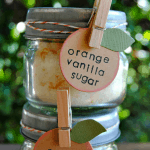 orange vanilla sugar in small jars with labels stacked on one another