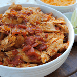 Slow Cooker Shredded Chicken is a staple in our house for easy meals! The flavorful, tender chicken is perfect for tacos, nachos, burritos and taco salads!