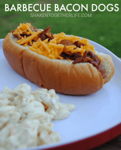 Barbecue Bacon Dogs are perfect for outdoor entertaining! Grilled hot dogs topped with barbecue shredded pork, bacon and cheese are a simple and delicious meal that your family and guests will love!