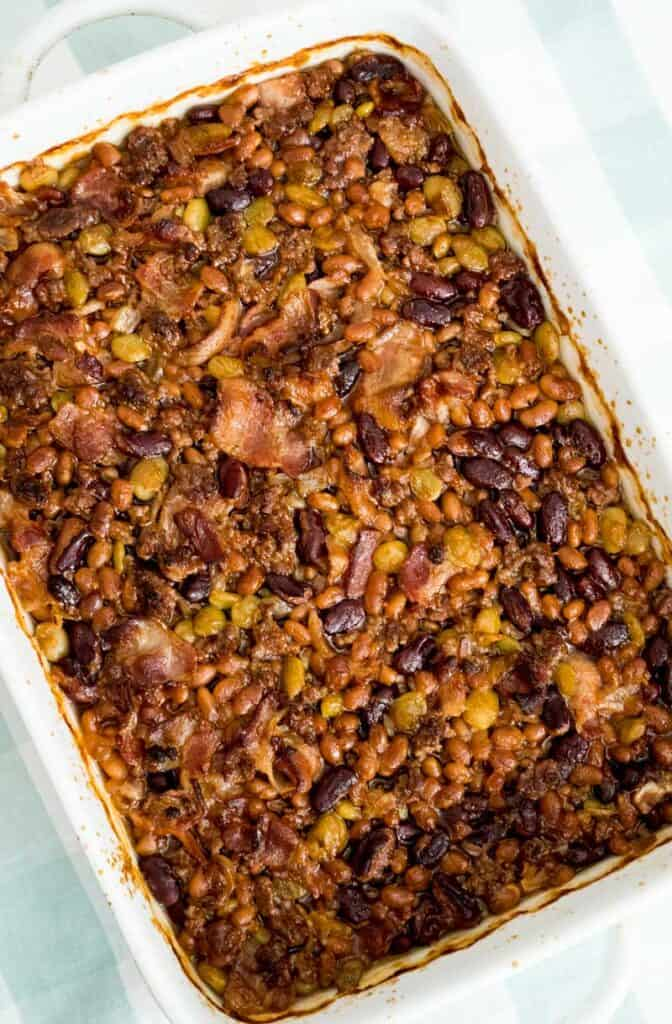calico beans baked beans in white baking dish