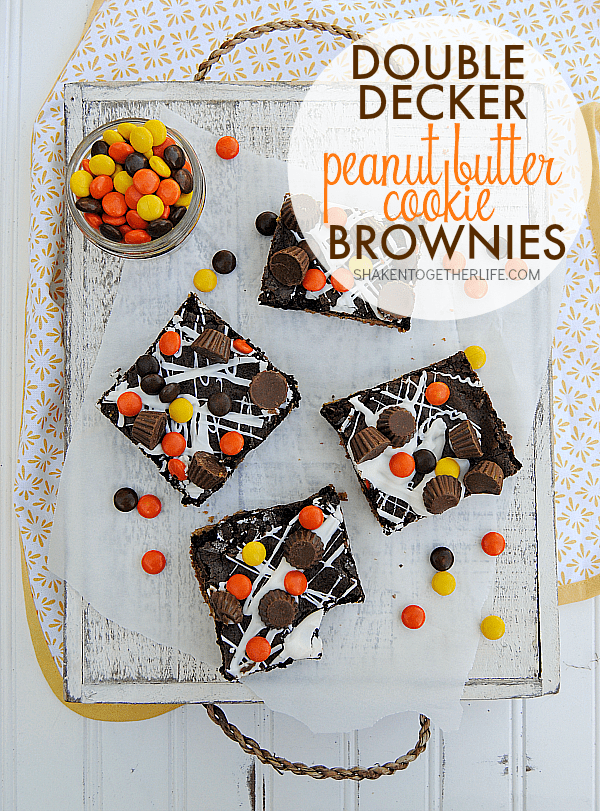 Double Decker Peanut Butter Cookie Brownies are outrageously delicious! Peanut butter cookie, triple chocolate brownie, white chocoalte drizzle, Reeses Pieces AND mini Reeses peanut butter cups ... hold on to your taste buds!!