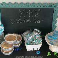 Need a unique birthday party favor idea? Let your guests pack up fresh baked cookies, frosting, birthday printed M&Ms and sprinkles to go from the M&Ms Cookie Bar!