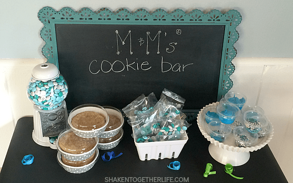 Need unique birthday party favors? Let your guests pack up fresh cookies, frosting, birthday birthday M&M's and sprinkles to go from the M&M's Cookie Bar!