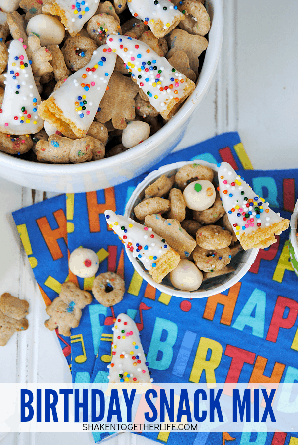 Sprinkled cereal, birthday cake flavored graham bears, cupcake bites and chocolate covered Bugle party hats are mixed together for this sweet and salty Birthday Snack Mix!