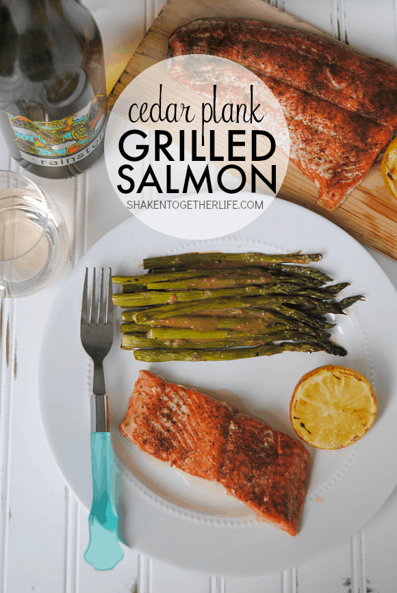 Cedar Plank Grilled Salmon - so much easier than we thought!  Grilled until tender and flaky, this salmon is perfectly paired with grilled lemons, asparagus and Rainstorm Wine!