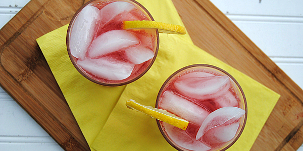 Bright, tangy and refreshing, a Pom Lemonade Fizz Mocktail {a non-alcoholic twist on a Sloe Gin Fizz} is perfect for poolside lounging and Summer entertaining!