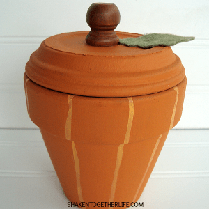 Transform a terra cotta pot and saucer into an adorable pumpkin!