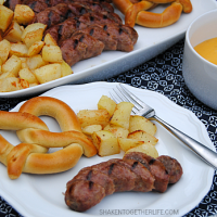 Grilled bratwurst dippers, roasted potatoes and soft pretzels are perfect to dunk in this easy cheese sauce! What a fun way to do dinner!