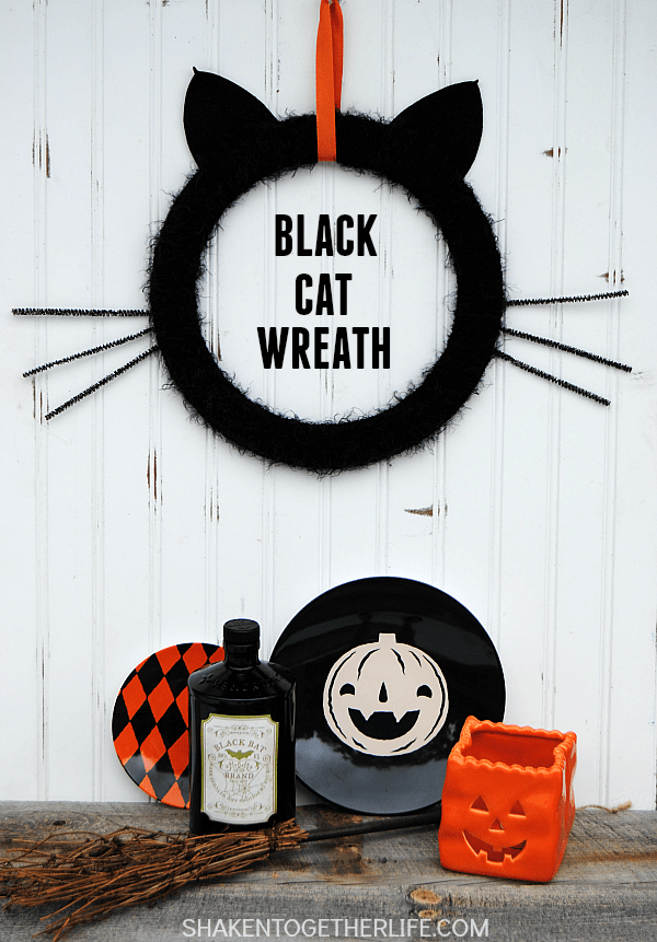 Give your front door or mantel a touch of frightfully furry fun with this easy Black Cat Wreath!