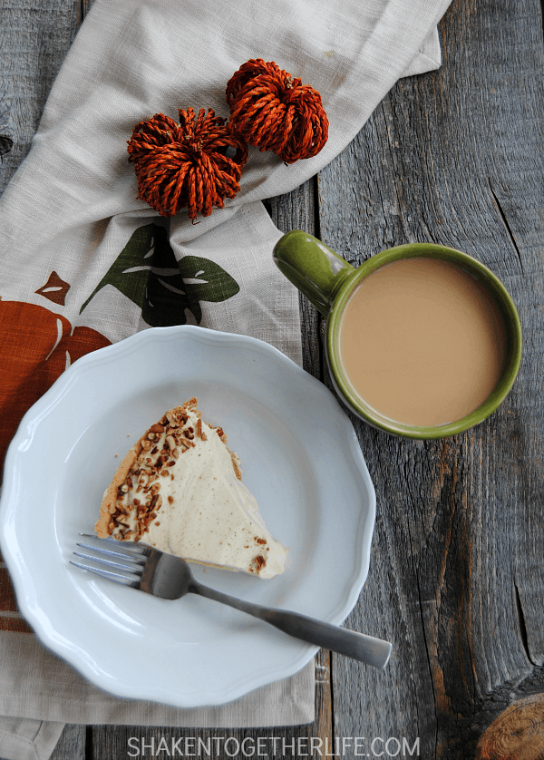 This no bake Pecan Pumpkin Pie is an easy twist on a classic holiday dessert!  The light and fluffy filling has a ton of pumpkin spice flavor.  It is piled inside a graham cracker crust and garnished with salted, toasted pecans!