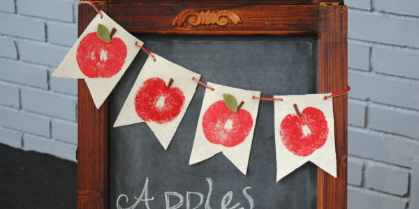 This easy Stamped Felt Apple Banner was inspired by the crisp apples and warm cider of Fall!