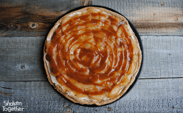 With a snickerdoodle cookie crust, brown sugar cream cheese, spiced apple pie filling and a decadent drizzle of caramel, this Snickerdoodle Caramel Apple Dessert Pizza will disappear slice by sweet slice!