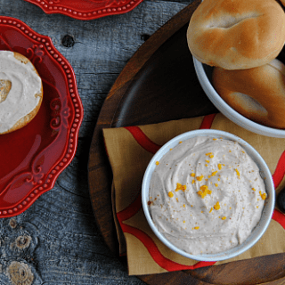 Homemade Cranberry Orange Cream Cheese is a delicious spread for bagels, sandwiches and scones! With a touch of cinnamon, fresh orange zest and cranberry, it tastes like the holidays!