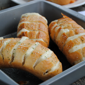 Mozzarella Stuffed Garlic Rolls are a quick and easy side dish! Our family loved to pull apart these ooey gooey cheesy rolls!