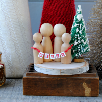 I cannot handle the cuteness of this Mini Christmas Wooden Family! LOVE the bottle brush tree and teeny tiny banner! These would make awesome Christmas gifts!