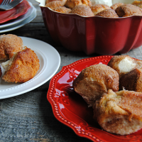 Cream Cheese Stuffed Monkey Bread Bites! These start with refrigerated biscuits, get stuffed with your favorite flavor of cream cheese, rolled in cinnamon sugar and baked into sweet little bites of delicious!